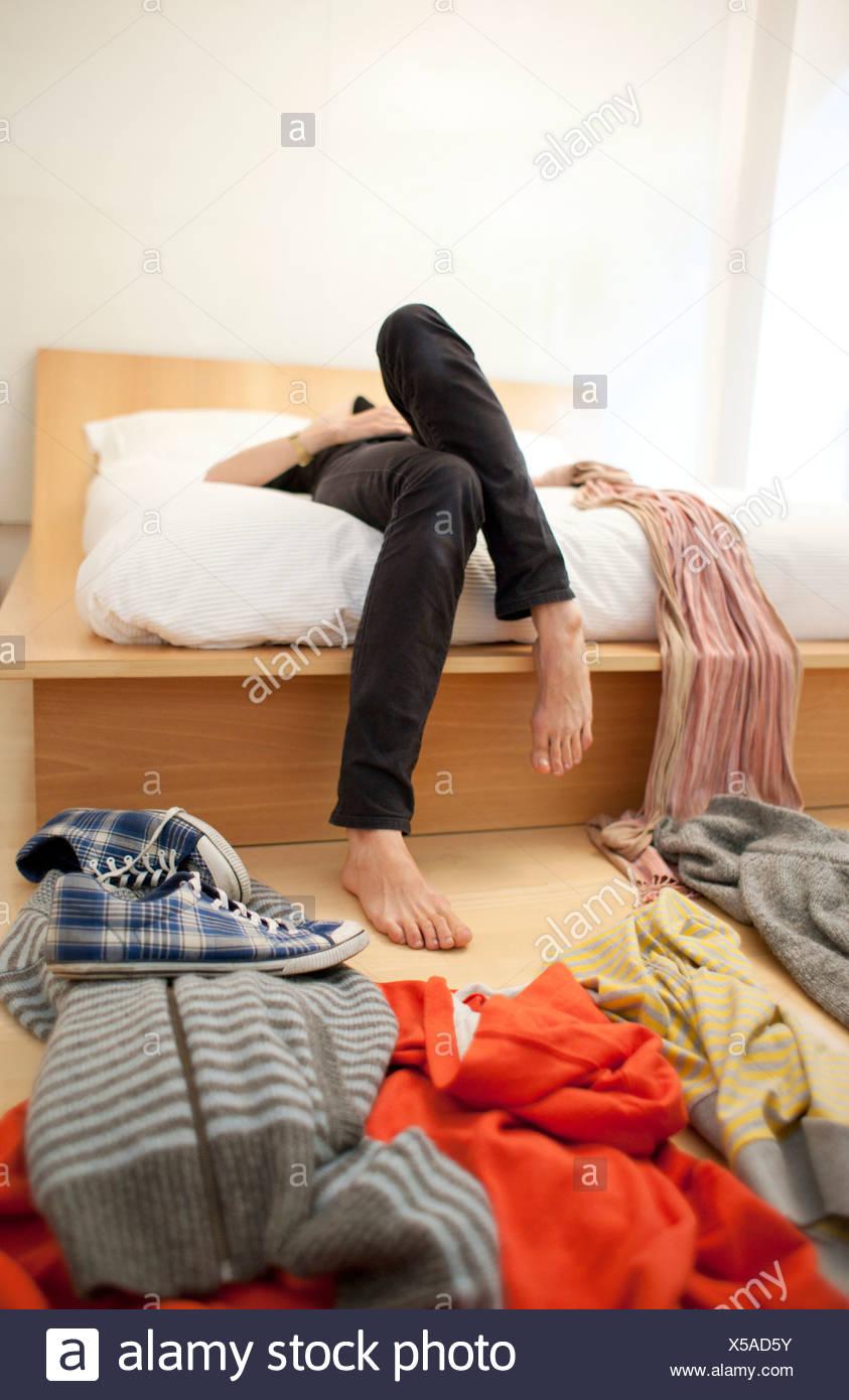 MODEL RELEASED. Woman's untidy bedroom. - Stock Image