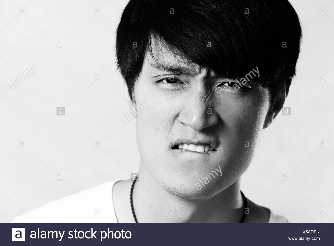 Young man looking angry - Stock Image
