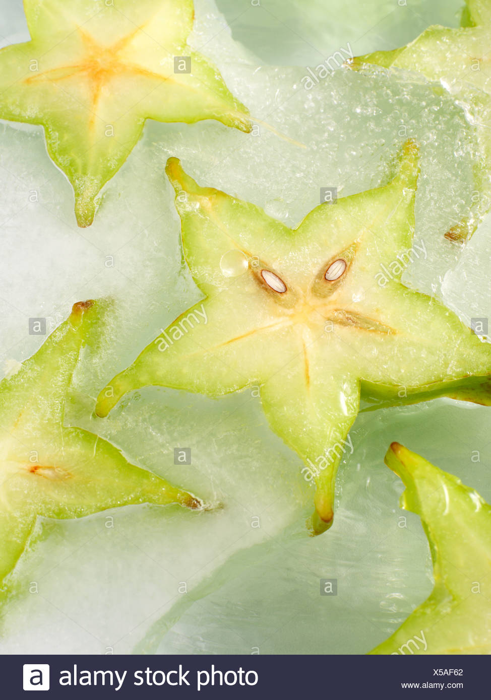 Frozen slices of star fruit - Stock Image