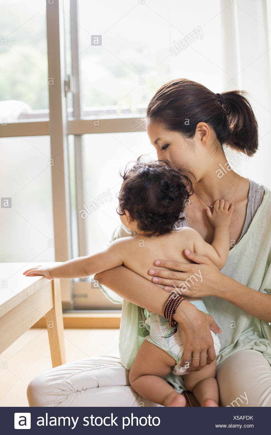 Mother holding her baby boy. - Stock Image