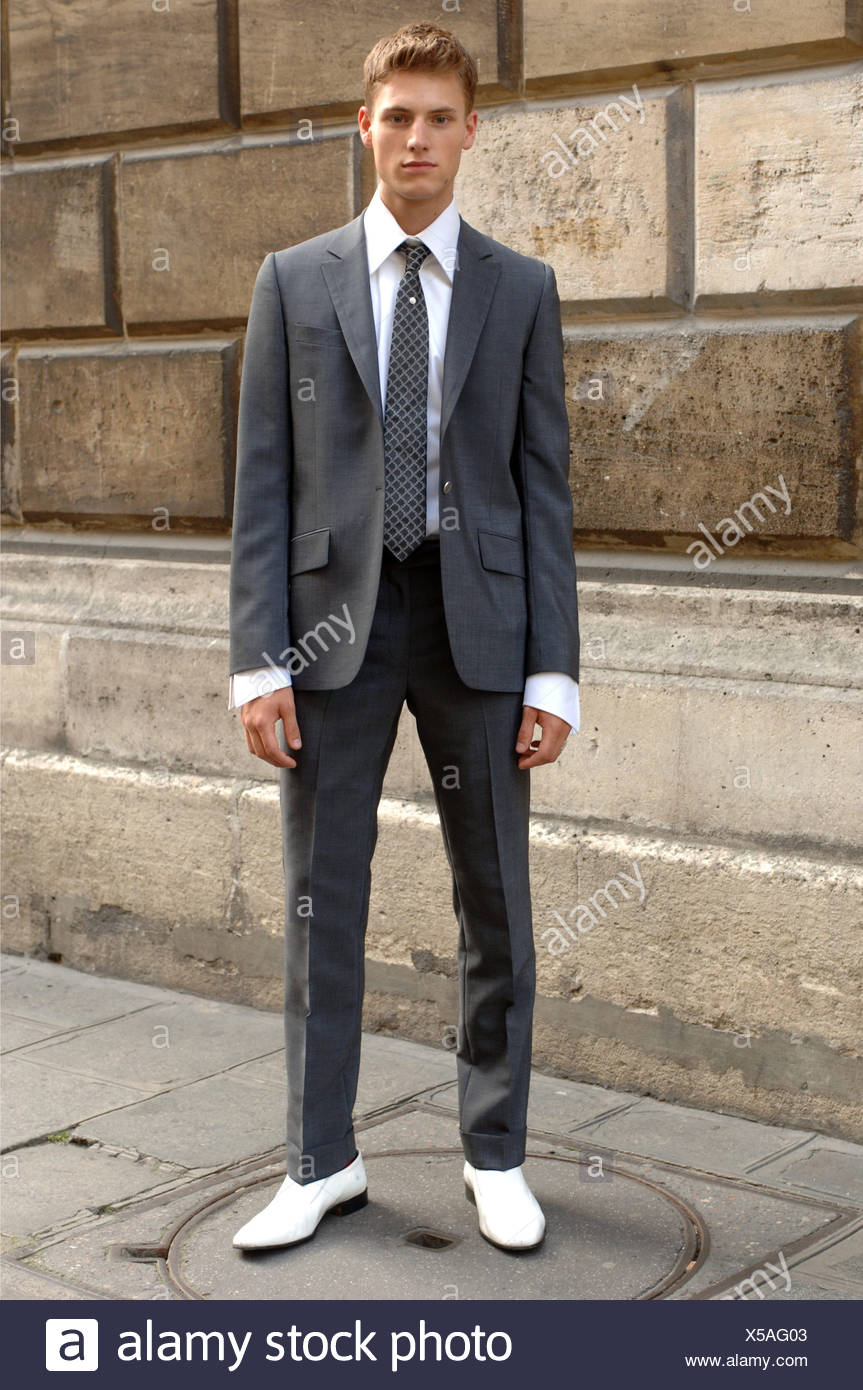 Karl Lagerfeld Paris Ready To Wear Menswear Spring Summer Blonde Male Model Wearing A Charcoal Grey Suit White Shirt And White Stock Photo Alamy