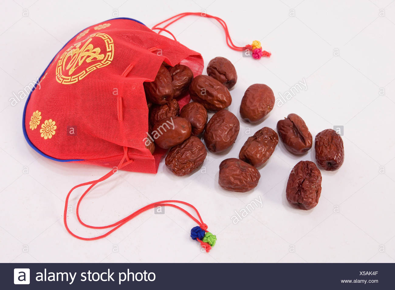 jujube spilled out from the lucky bag - Stock Image