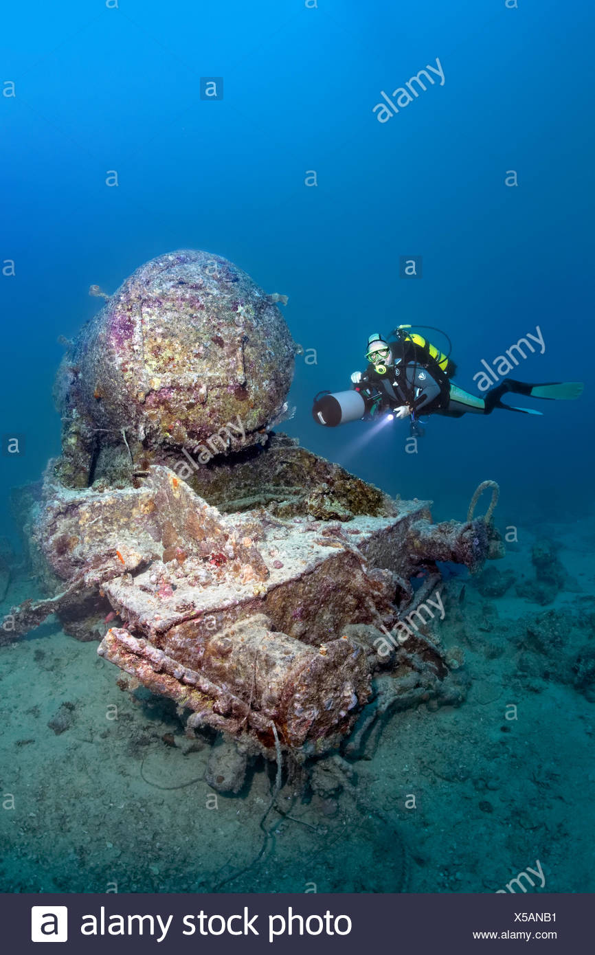 Scuba diver at the remains of a Stanier 8F locomotive, shipwreck of the SS Thistlegorm, Red Sea, Shaab Ali, Sinai Peninsula - Stock Image