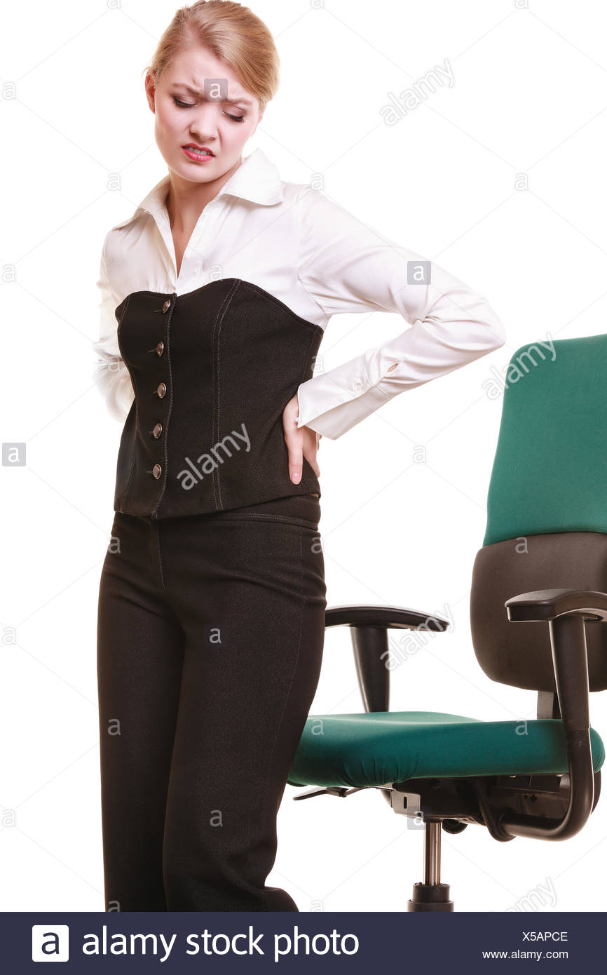 Businesswoman with backache back pain isolated - Stock Image
