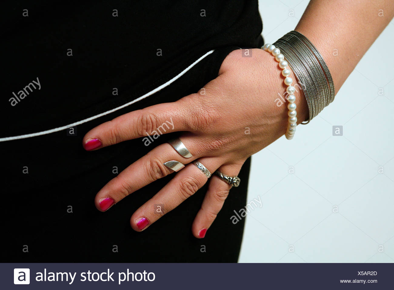 Hand with rings and bracelets - Stock Image