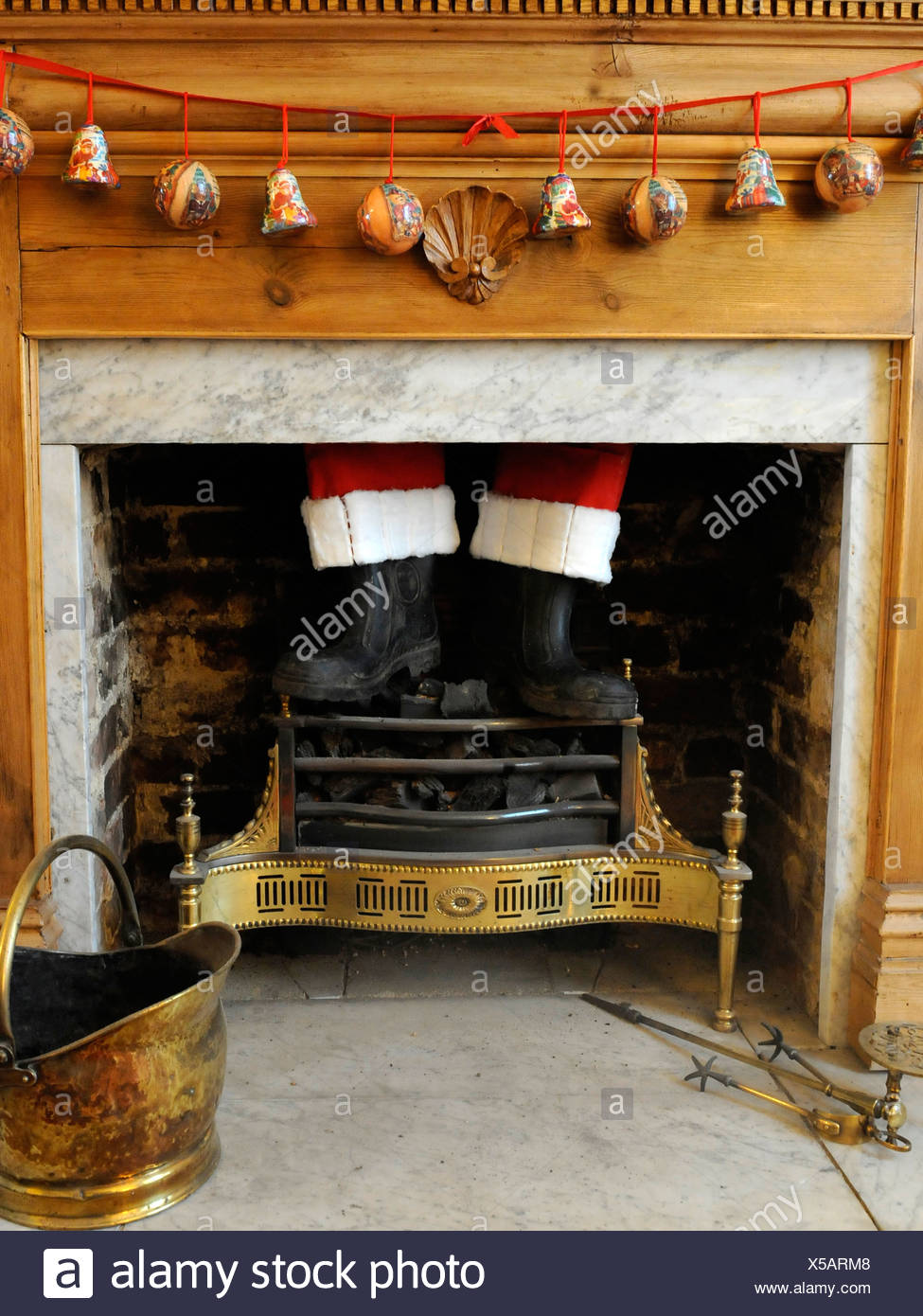 Father Christmas stuck in a chimney. - Stock Image