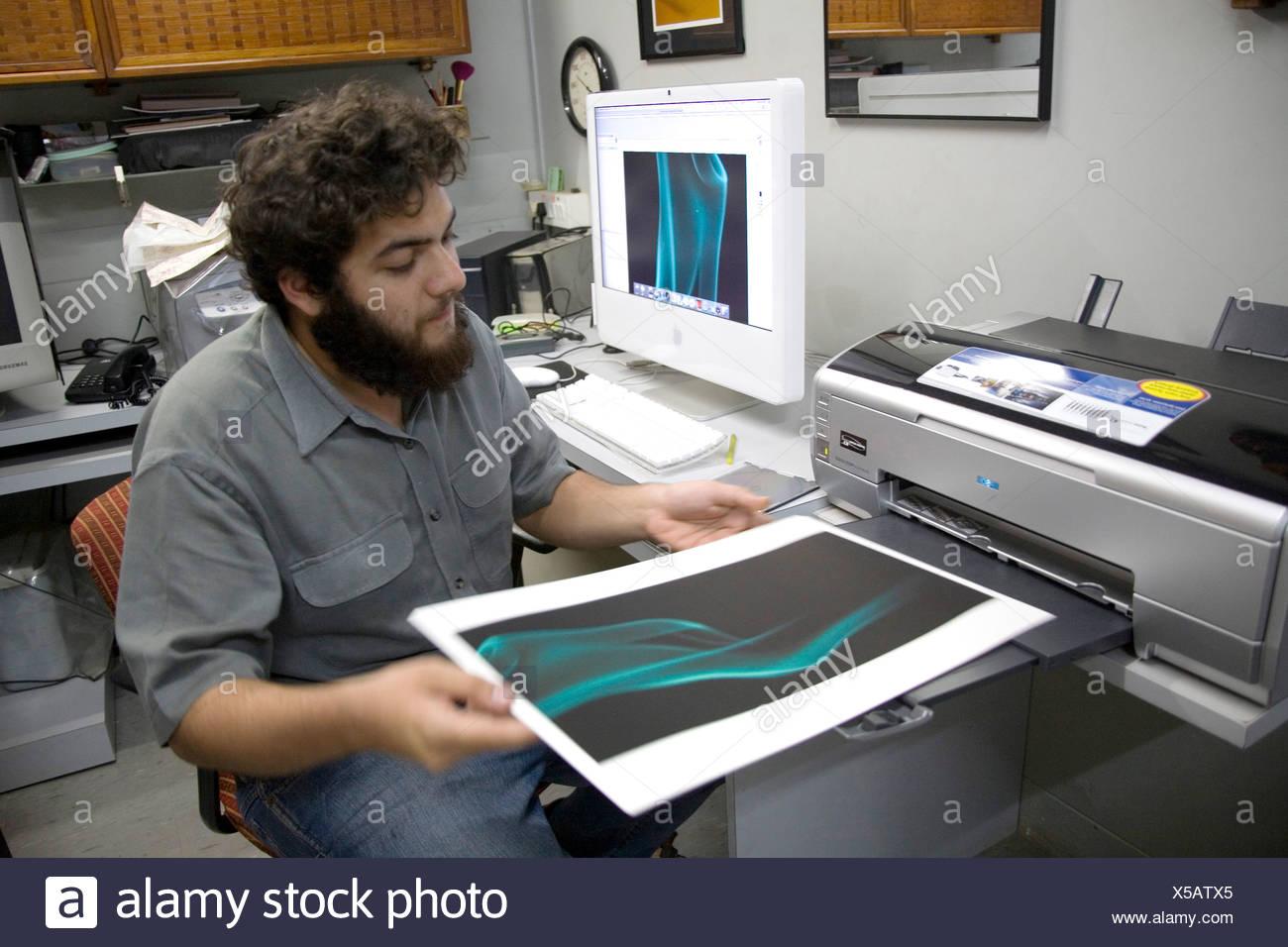 Vivek Manek photographer working on archival epson printer MR - Stock Image