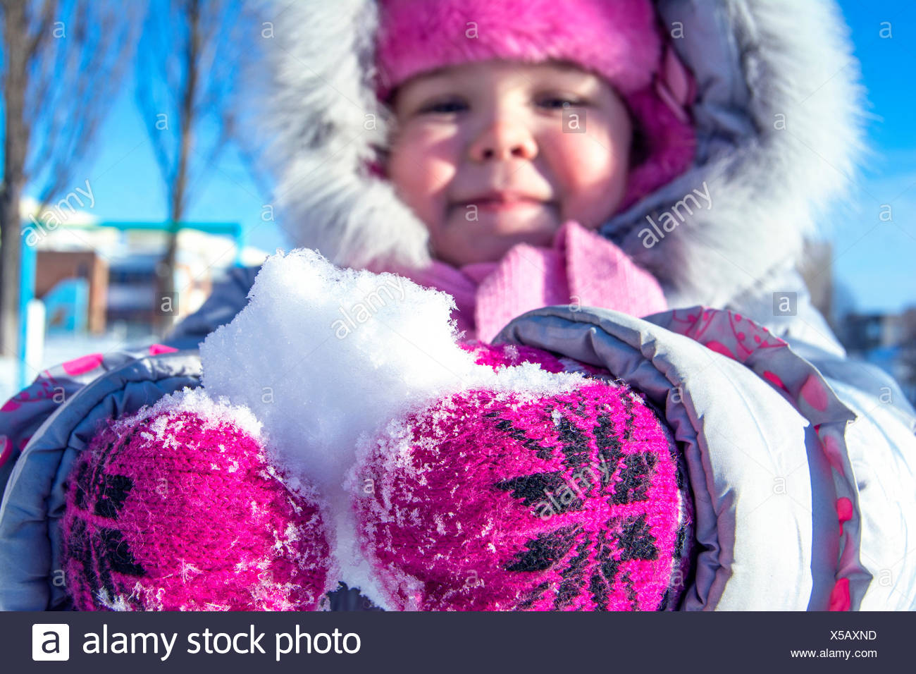 Close-Up Of Child Holding Snow - Stock Image