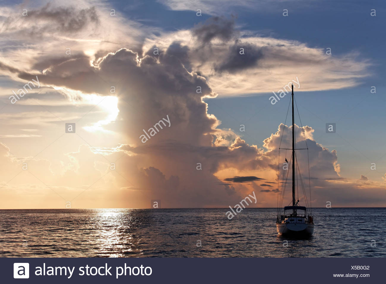Sailboat at anchor, large storm cloud, sunset, horizon, sea, Saint Lucia, LCA, Windward Islands, Lesser Antilles, Caribbean - Stock Image