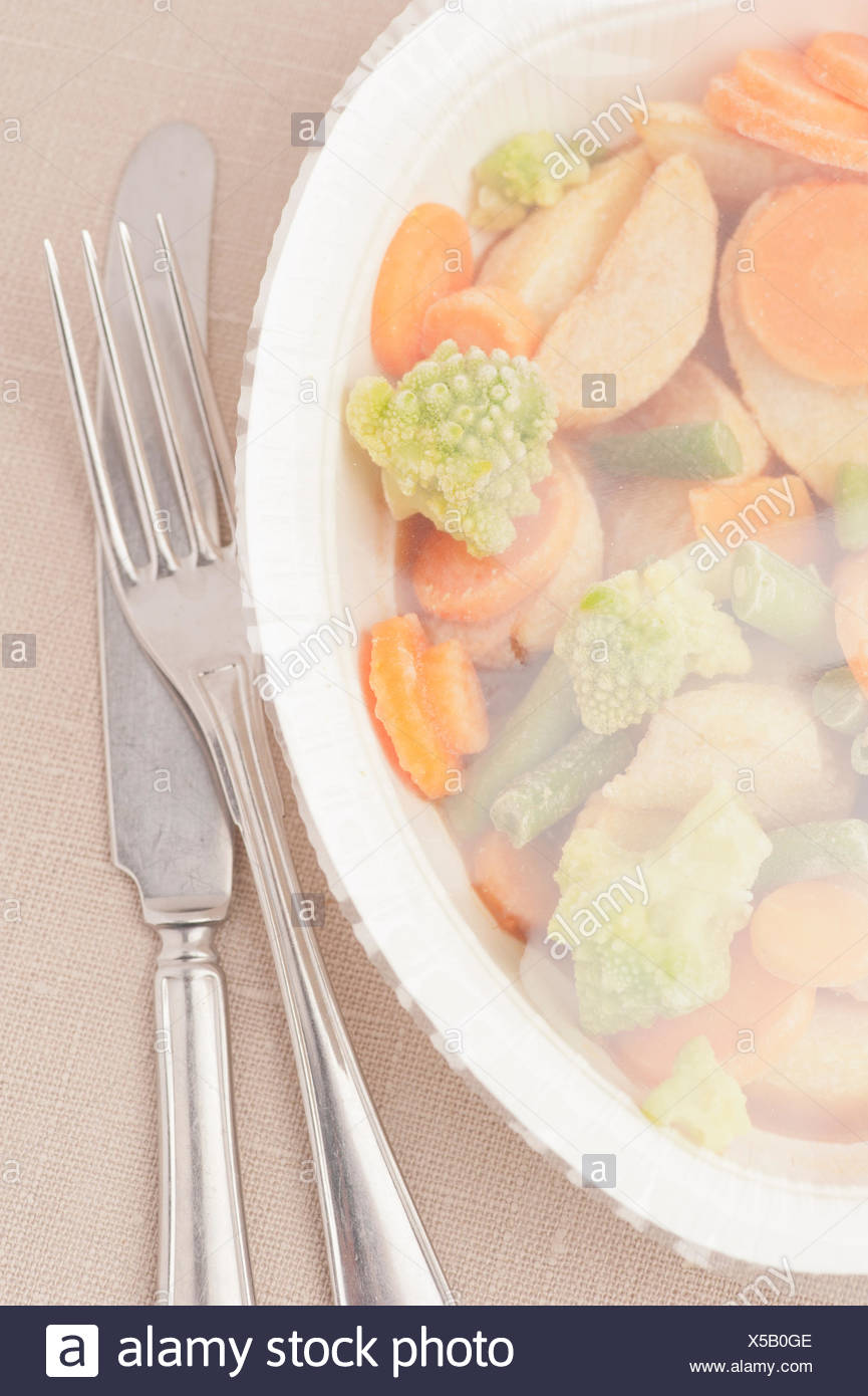 Frozen TV dinner with knife and fork - Stock Image