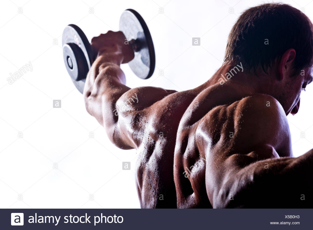 Close-up of a crossfit athlete working out. - Stock Image