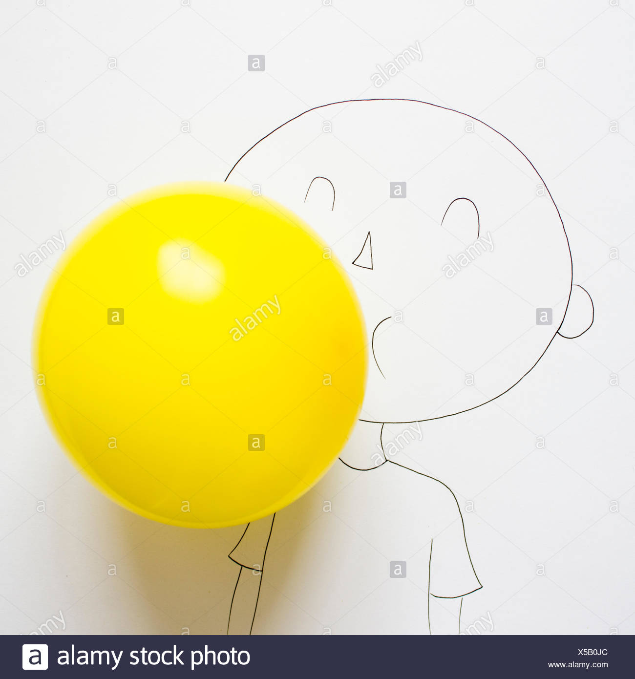 Conceptual drawing of a boy blowing up a balloon - Stock Image