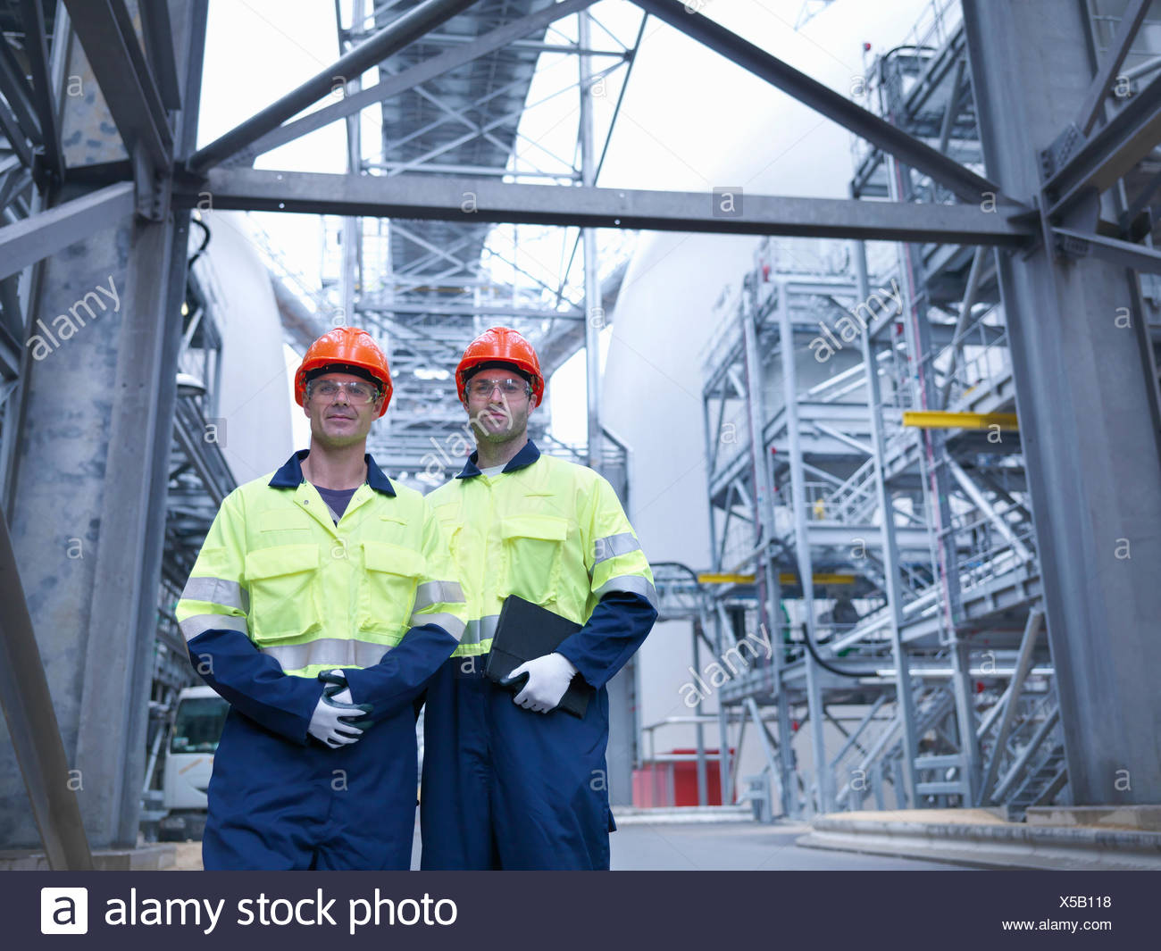 Portrait of workers in biomass facility - Stock Image
