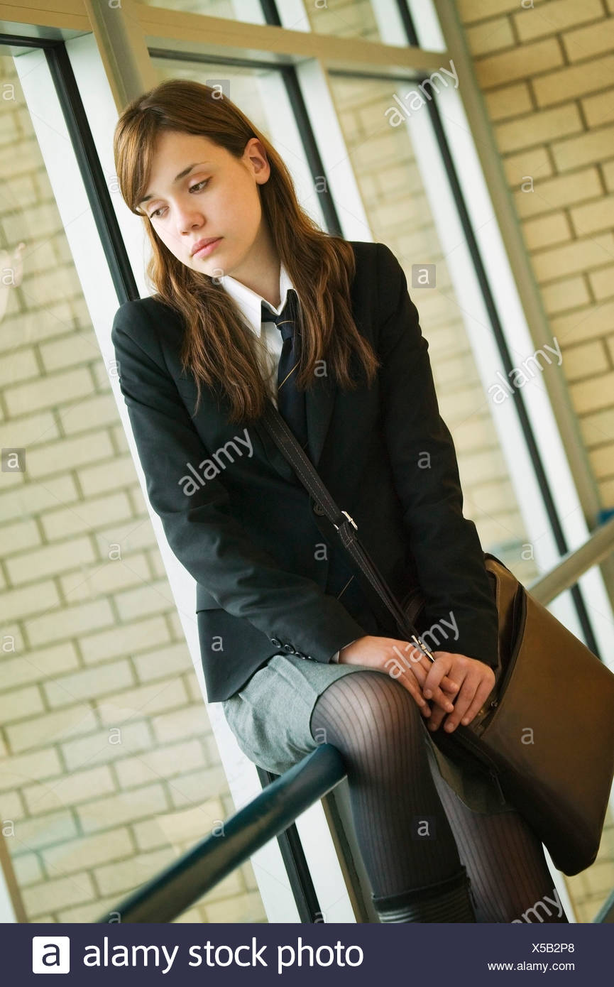 A student in uniform appearing forlorn - Stock Image