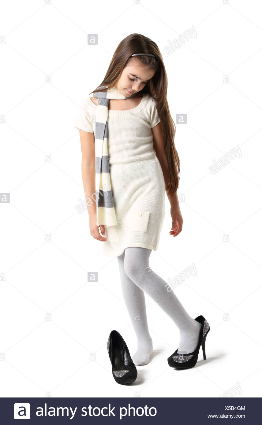 Little girl in mother's shoes Stock
