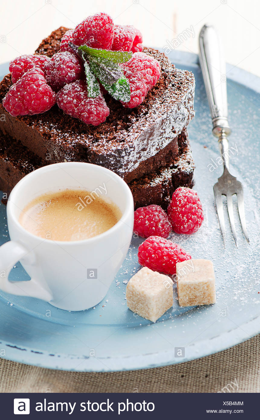 Chocolate cake with summer berries and coffee. - Stock Image
