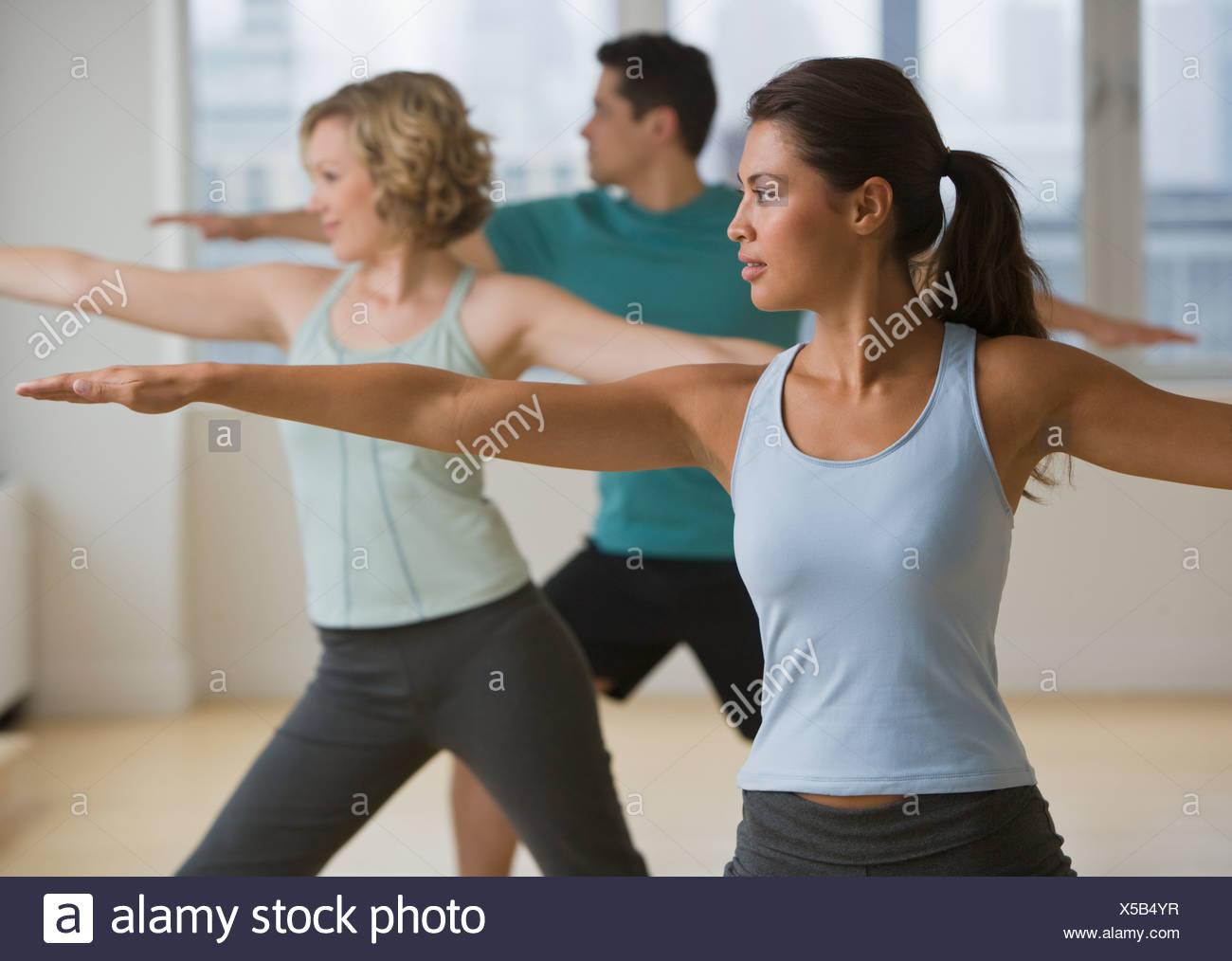 Multi-ethnic people in yoga class Stock Photo