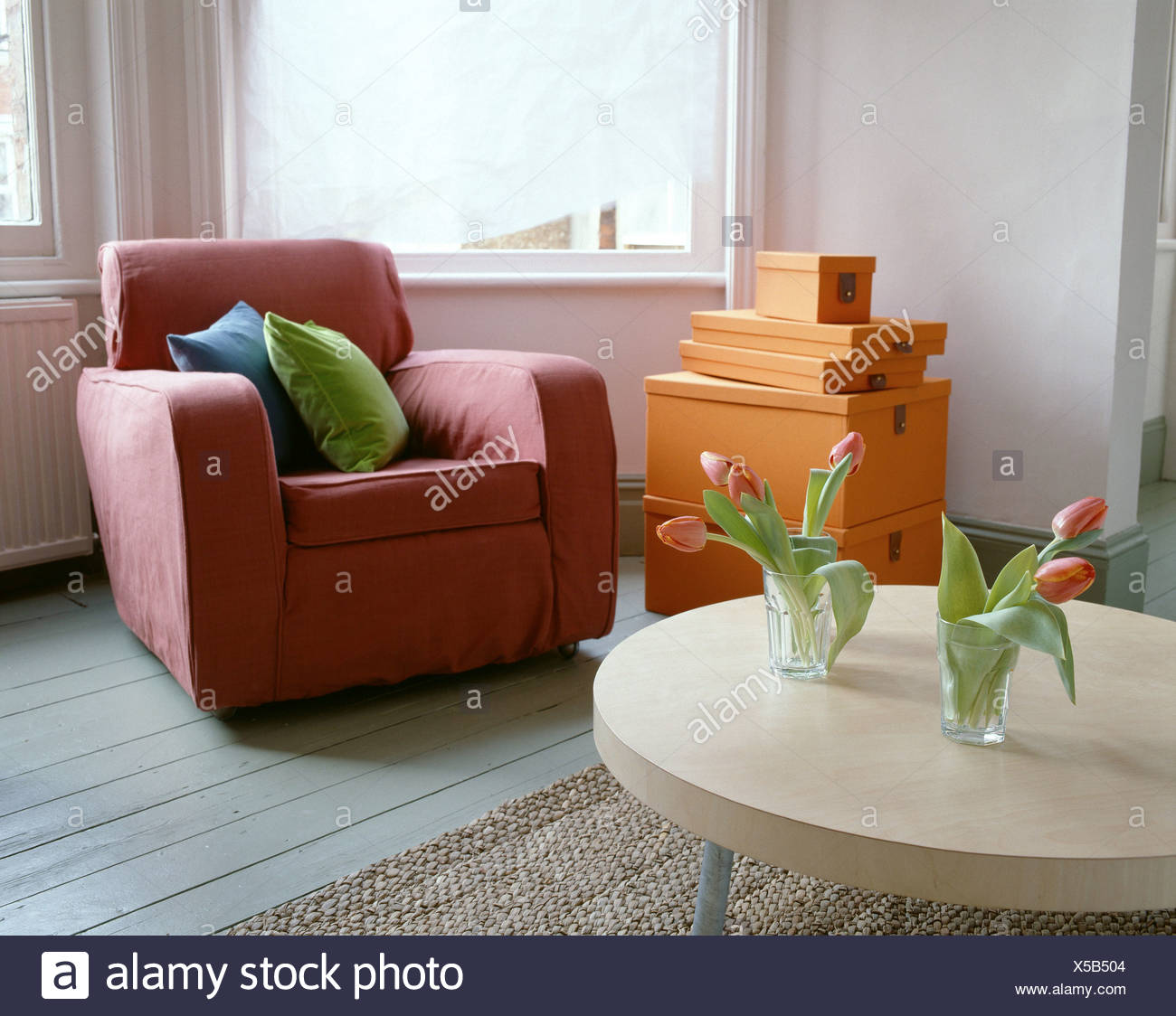 living and dining room makeover after living room red armchair rh alamy com