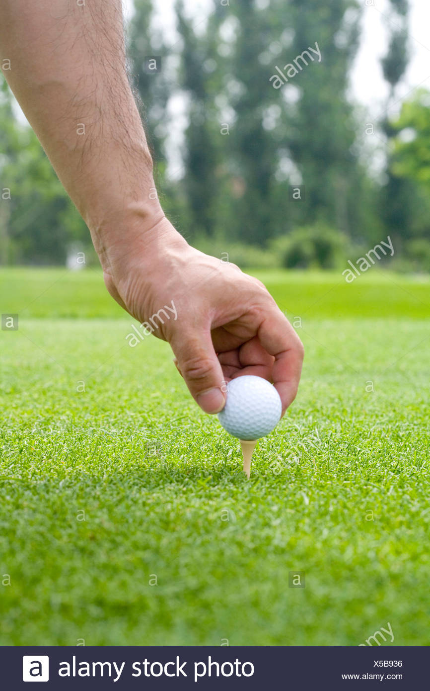 Close Up Of Putting A Golf Ball On Tee Stock Photo Alamy