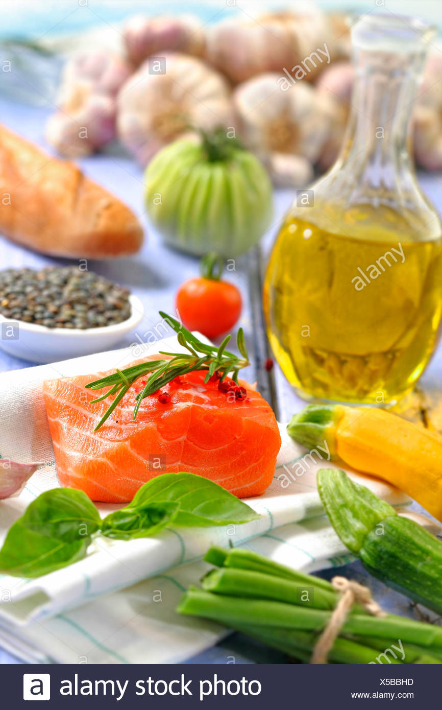 Thick piece of raw salmon and vegetables - Stock Image