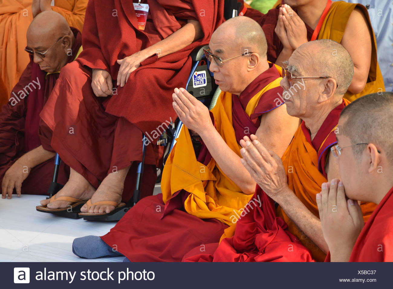 Buddhism, the Dalai Lama in a communal prayer with dignitaries, eg Karamapa, from all Buddhist branches and schools, gathering - Stock Image