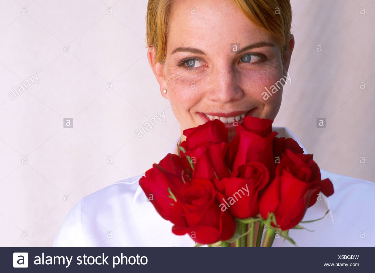 Woman with red roses - Stock Image