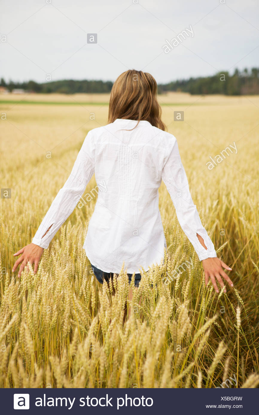 Young woman in wheat field Stock Photo
