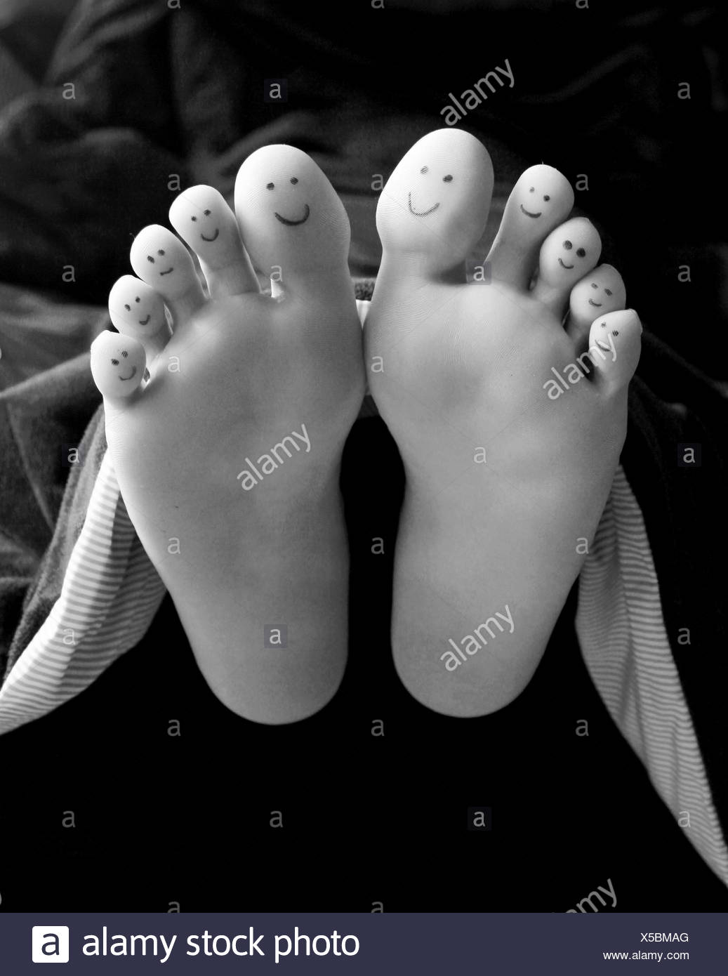smiley,foot,relaxing - Stock Image