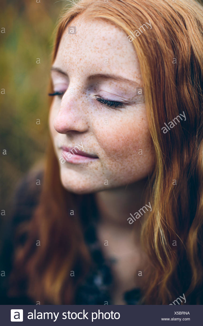 Portrait of girl (16-17) with eyes closed - Stock Image