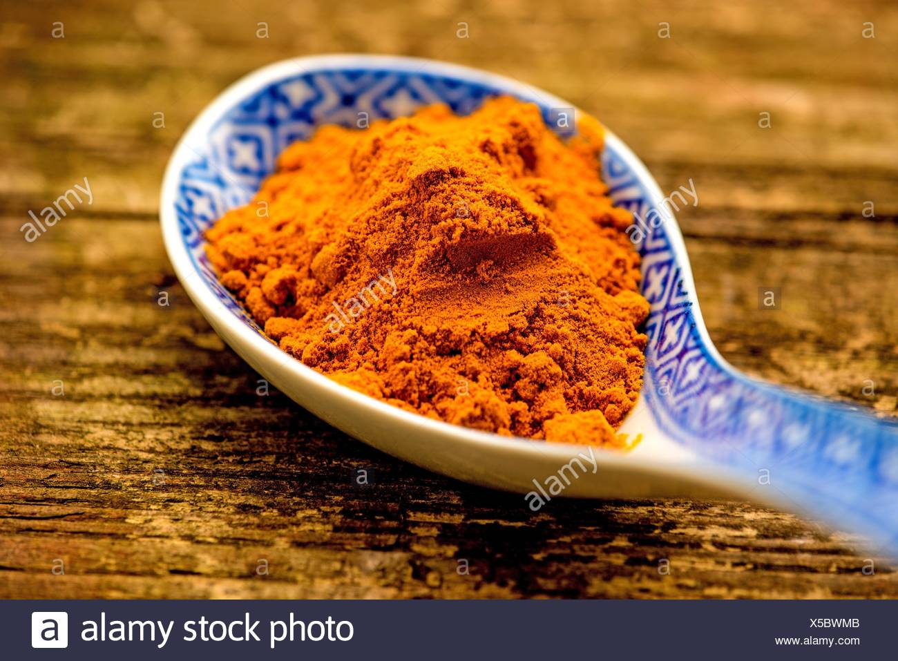 turmeric powder on a spoon. - Stock Image