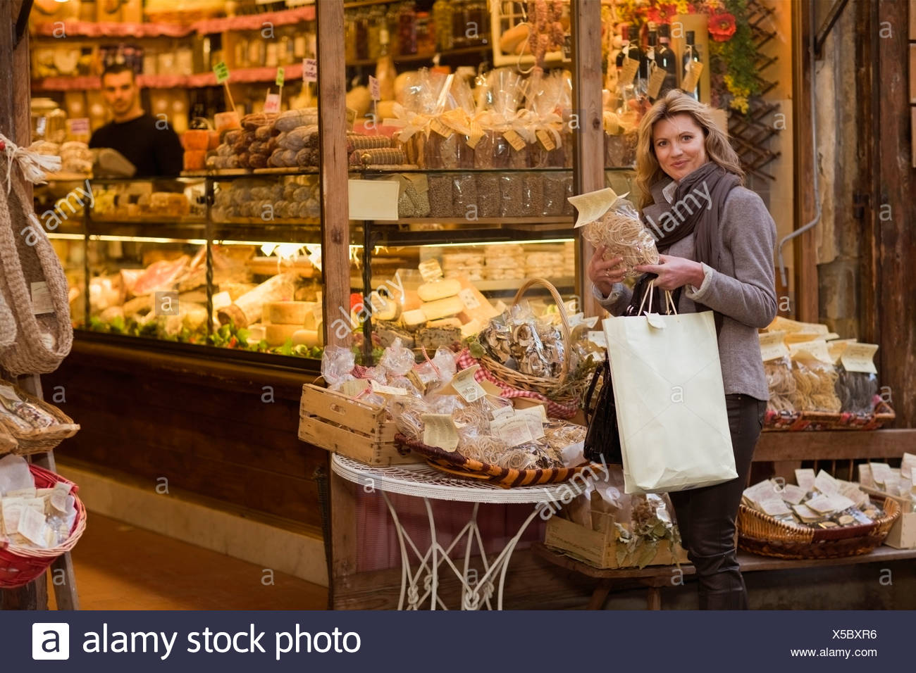 Woman in front of deli - Stock Image