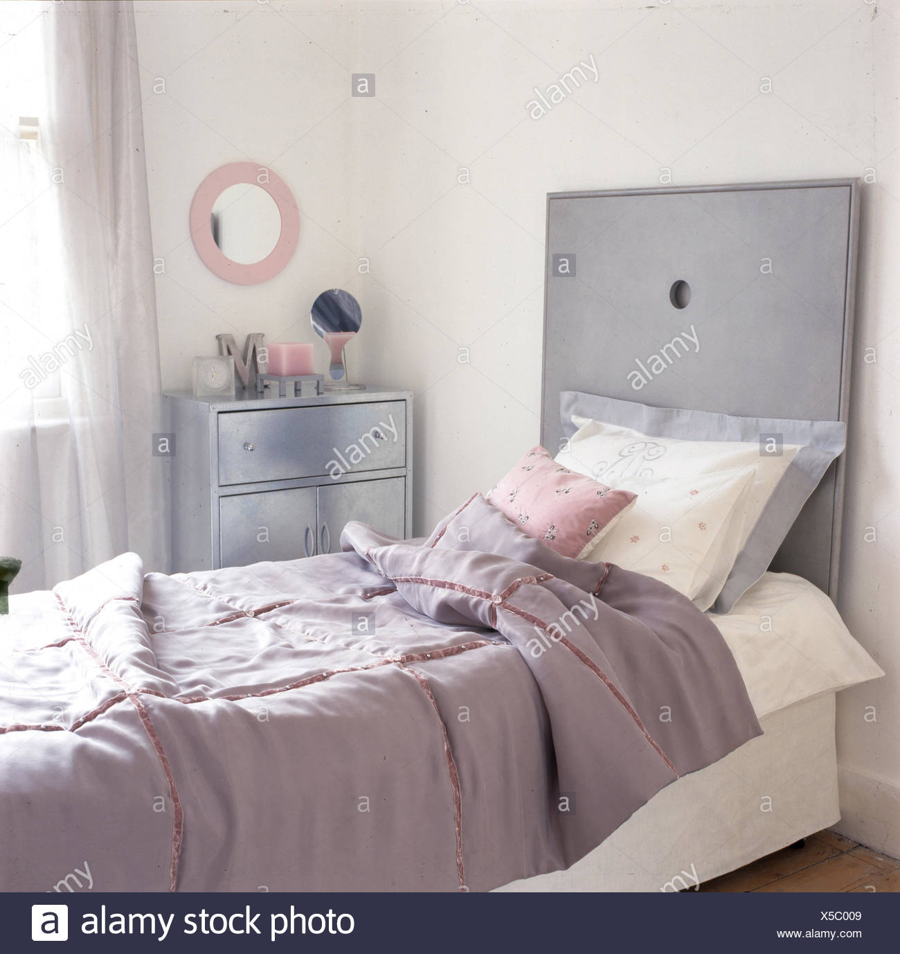 Single bed in feminine room with pink and grey colour scheme Stock ...