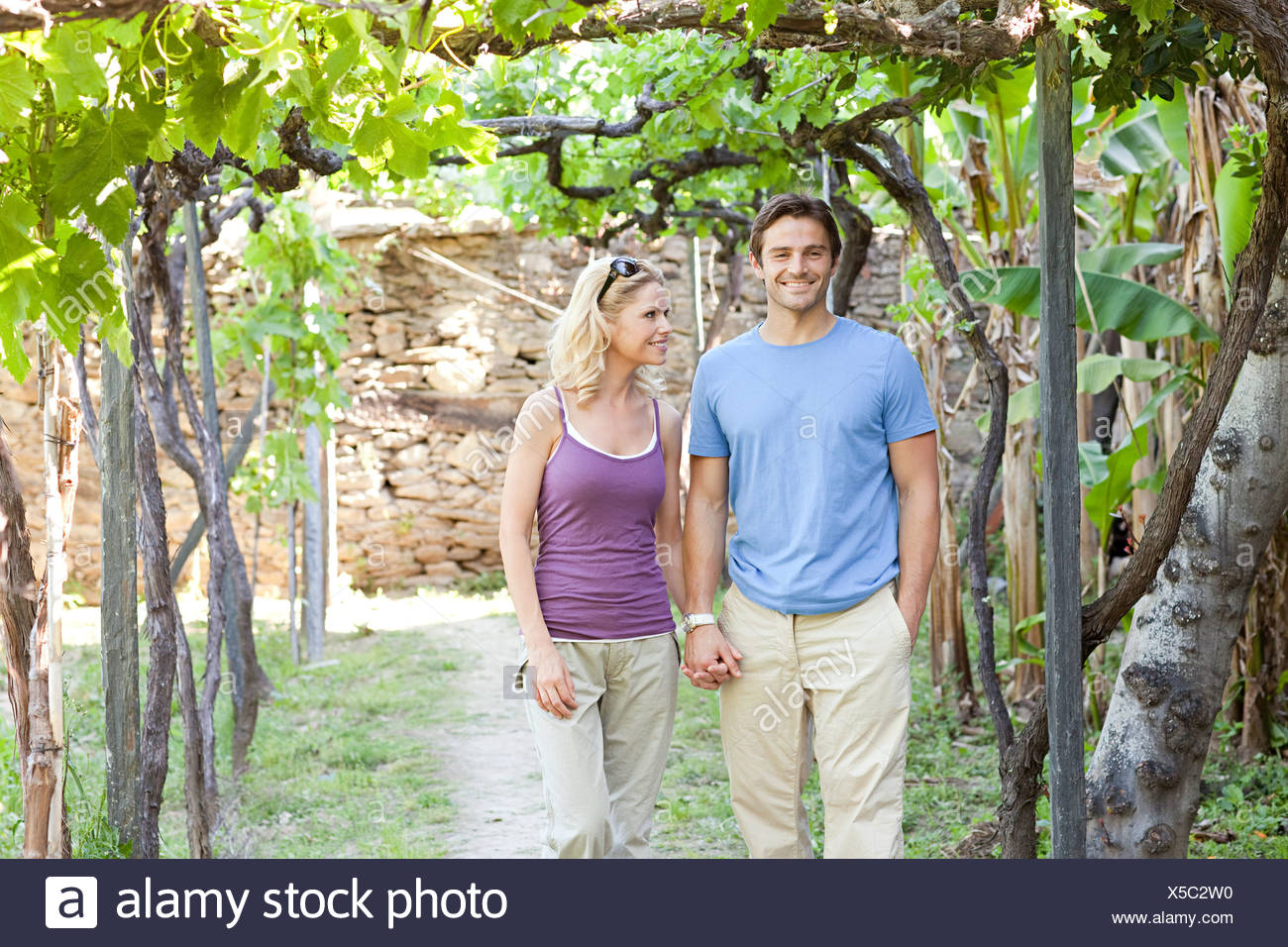 Couple in a vineyard - Stock Image