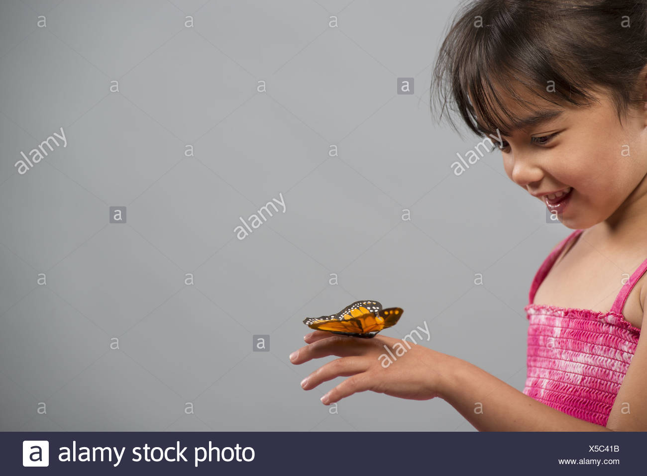 Utah USA child with butterfly on hand keeping very still - Stock Image