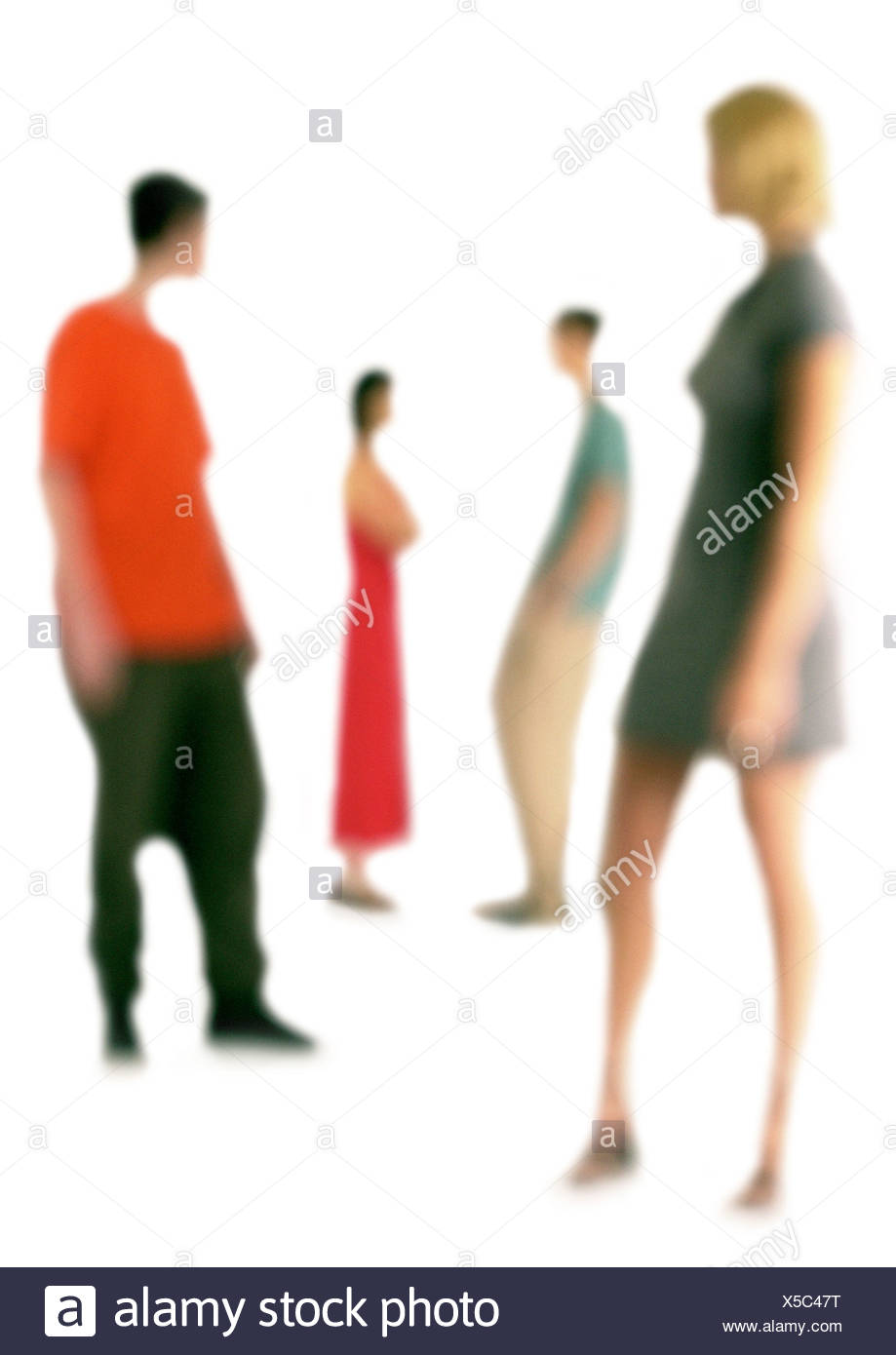 Silhouette of two couples standing apart, on white background, defocused - Stock Image