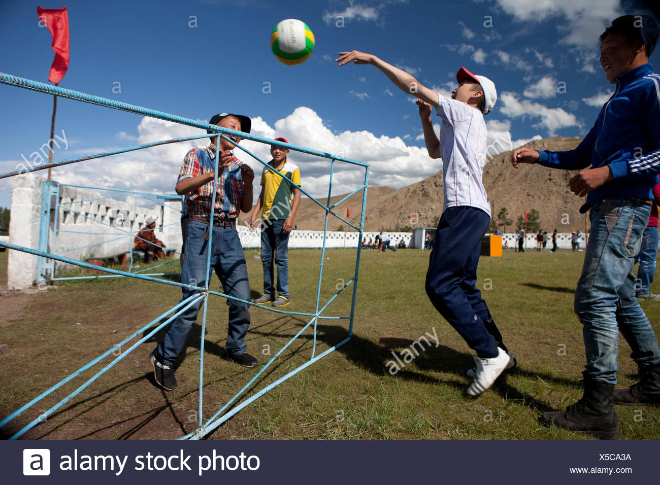 Mongol boys playing mini volleyball at Naadam Festival, Bunkhan, Bulgan, Mongolia - Stock Image