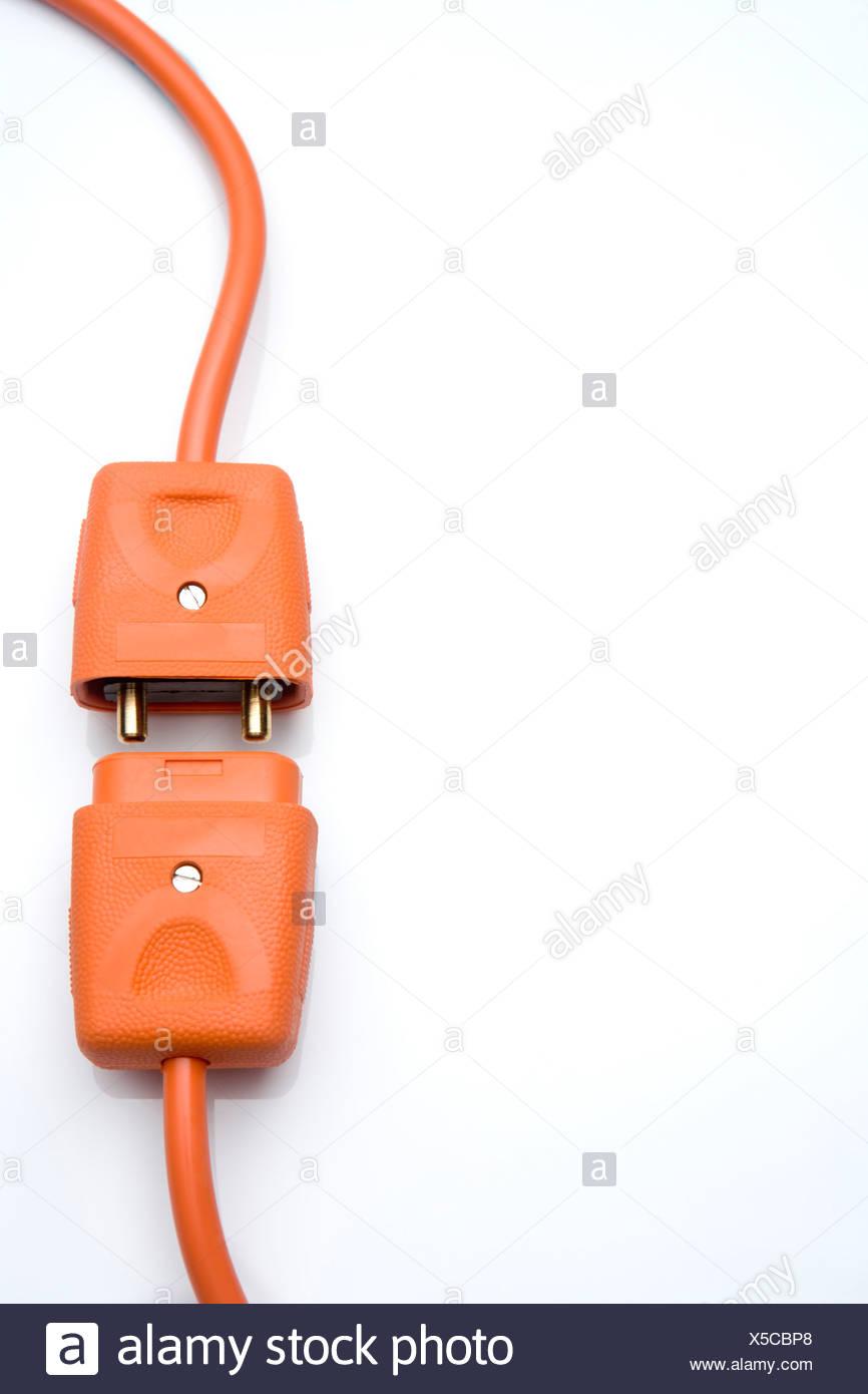 Two Orange Electric Plugs - Stock Image