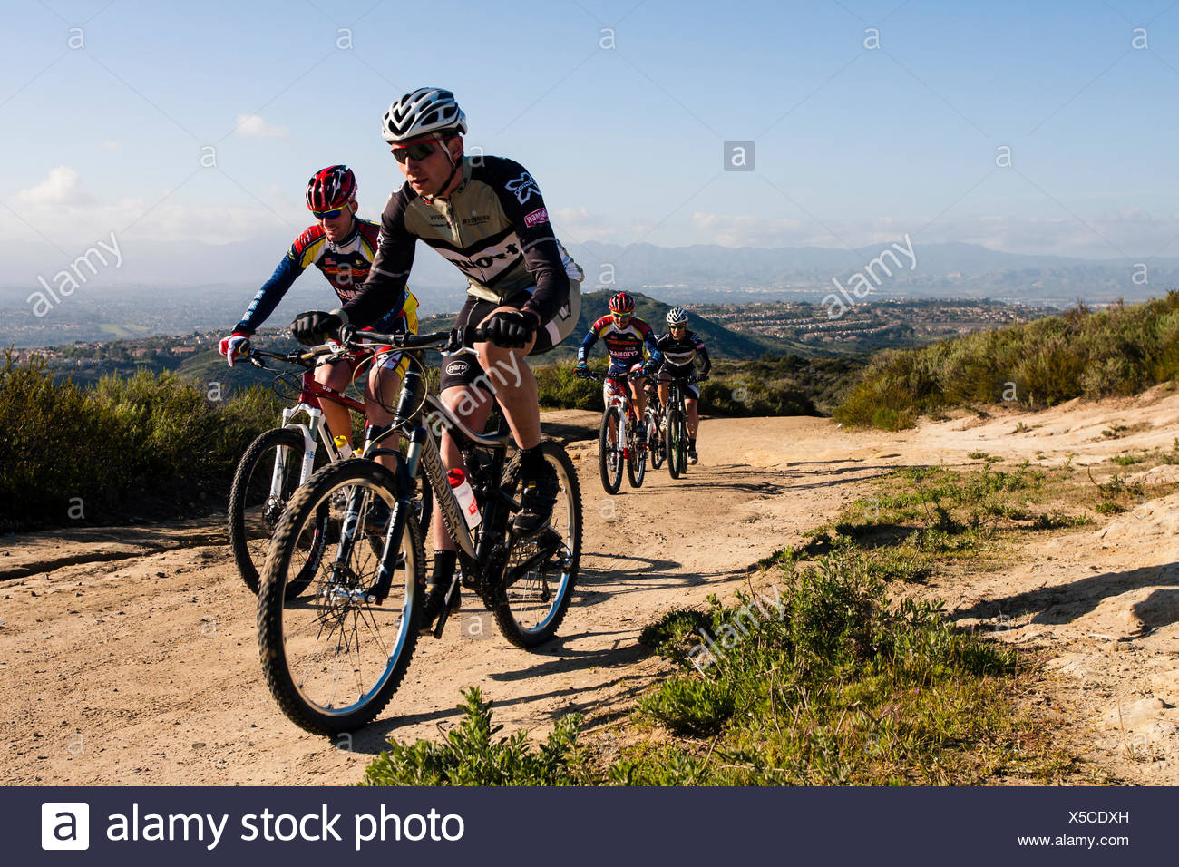 Riders from Troupe Racing and Cytomax KHS racing ride cross country together Southern Califonia. Feb 24th 2011 - Stock Image
