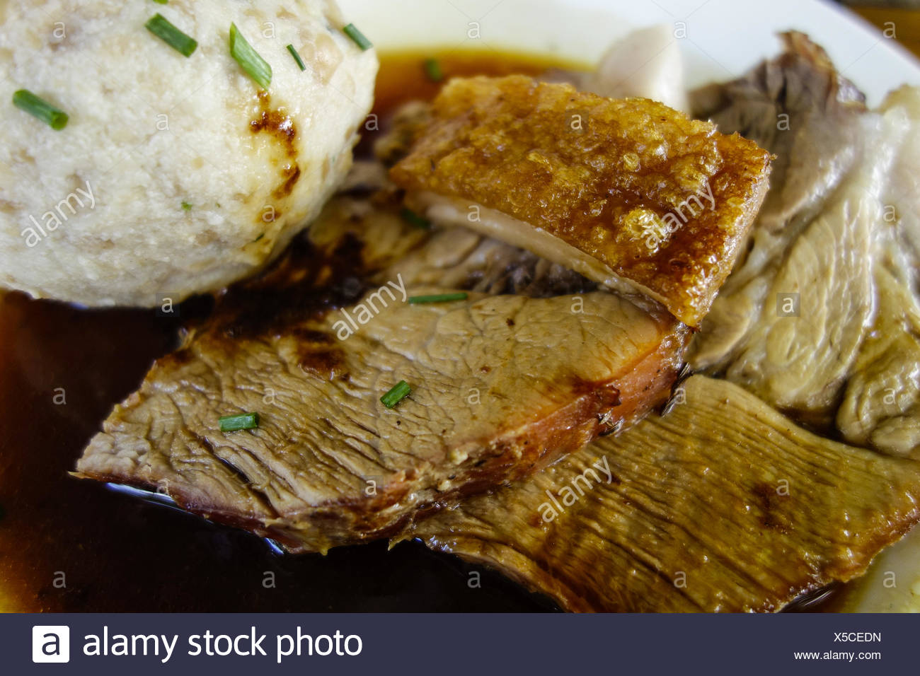 Bayerischer Schweinebraten mit Kruste und Knödel, Bavarian roast pork with crackling and dumplings, Bavarian, Specialty, Roast, - Stock Image