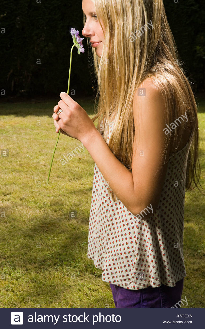 Young woman with flower - Stock Image