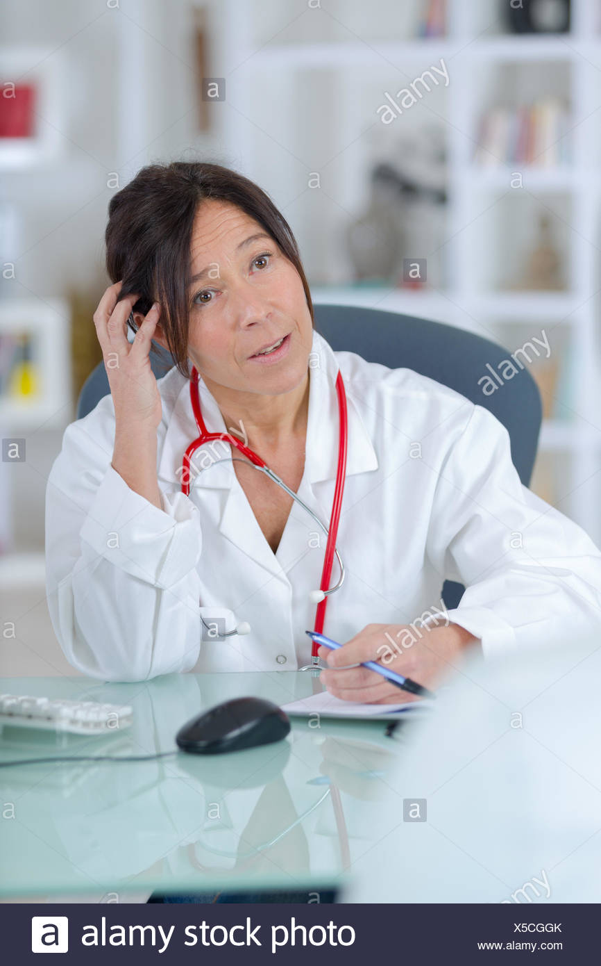 female doctor listening to her patient - Stock Image