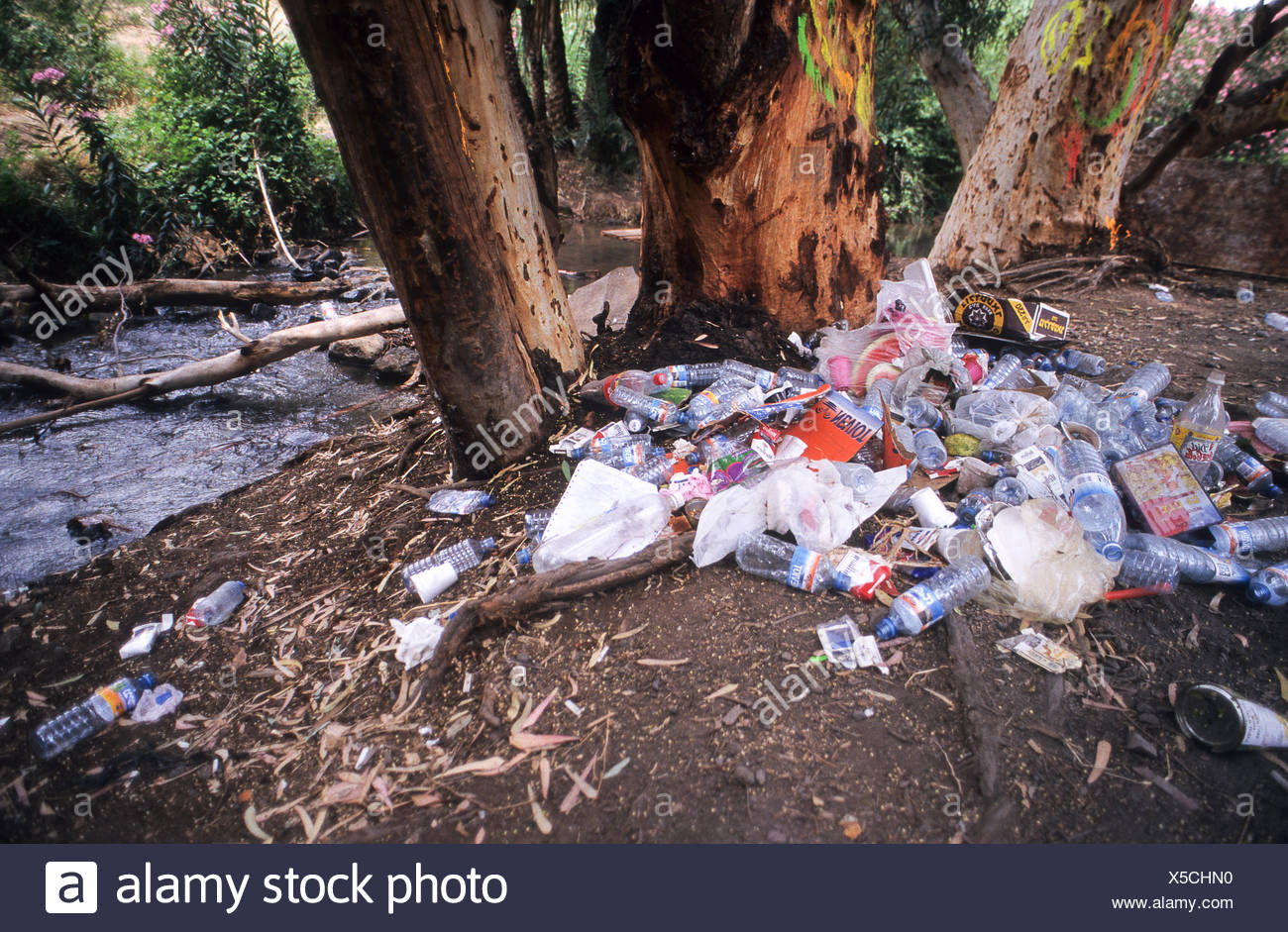 Garbage and waste left by hikers out in nature - Stock Image