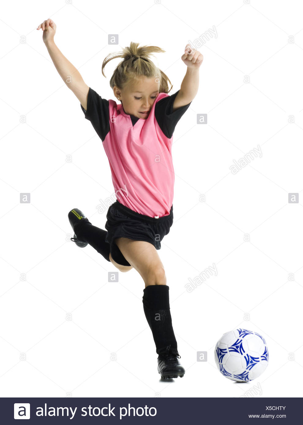dea02f482 Young girl in a soccer uniform with ball Stock Photo  278716619 - Alamy
