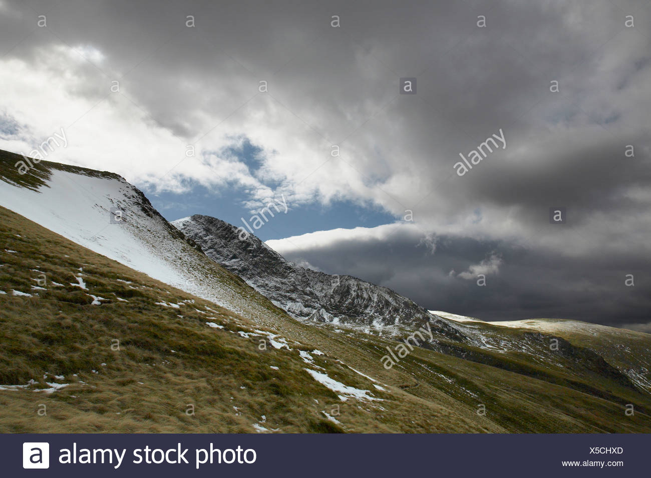 Snow covered hillside in Lake District National Park, England - Stock Image
