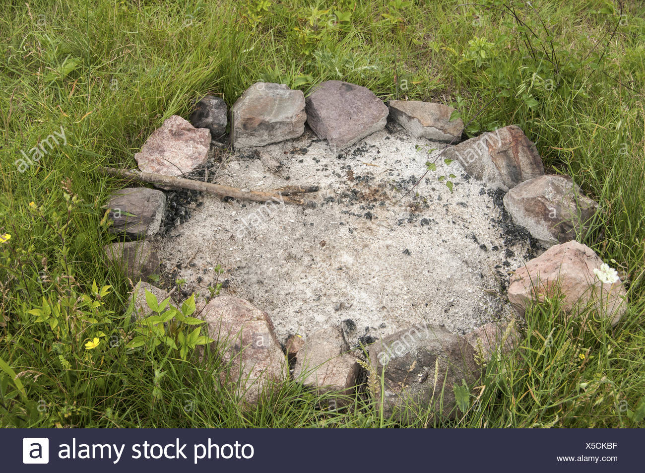 Unlit camp fireplace - Stock Image