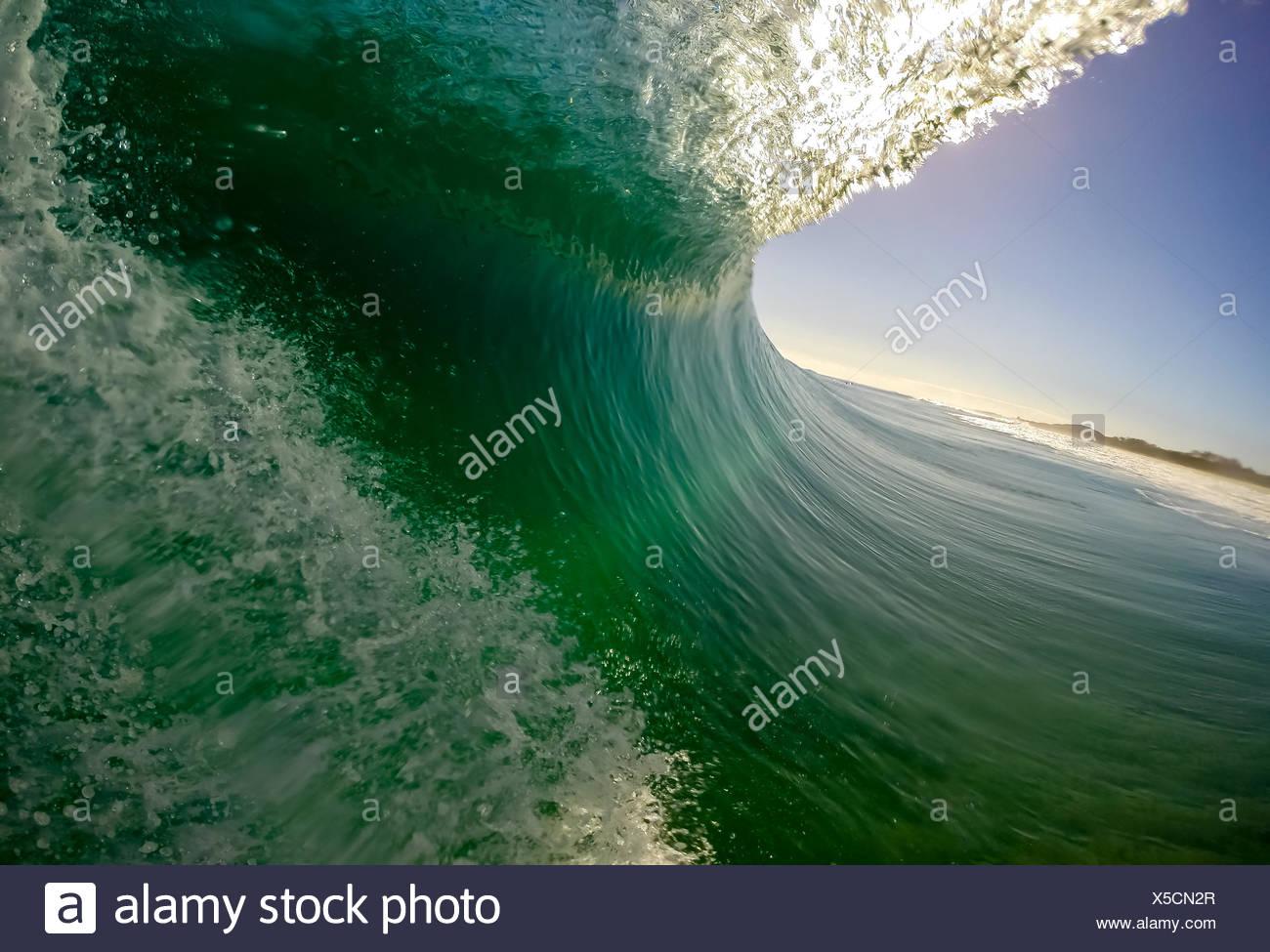 Australia, New South Wales, Wave on Black Rocks Beach - Stock Image