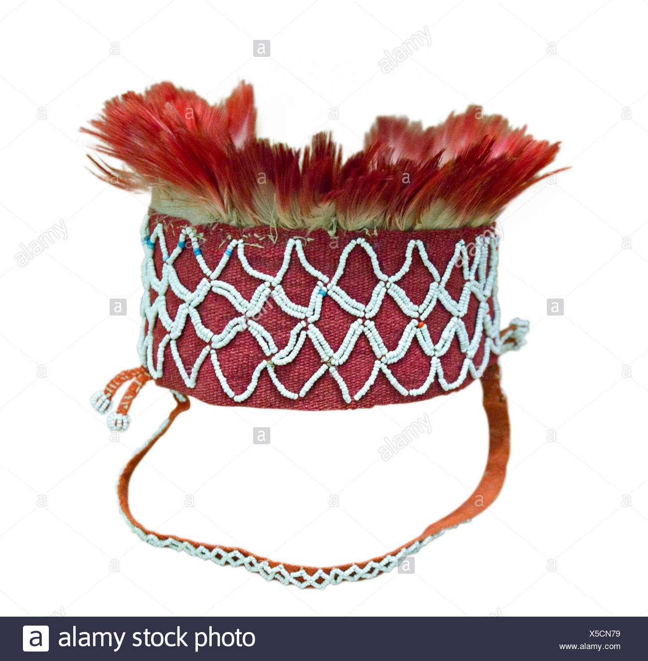 Headdress worn by men from the Pilaga tribe in Argentina.  Only those who had killed could wear red feathers. - Stock Image