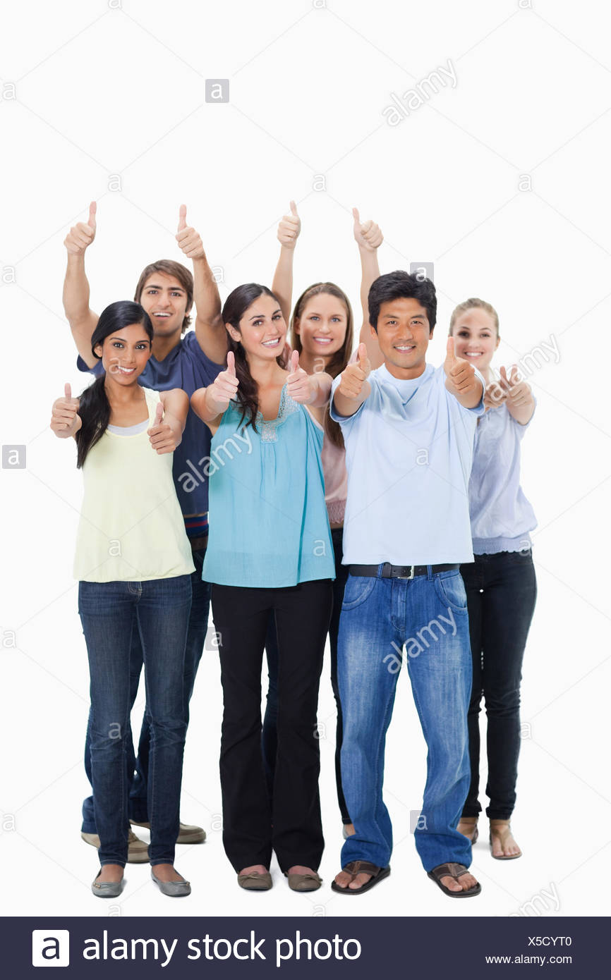 People smiling together and approving with the thumbs-up - Stock Image