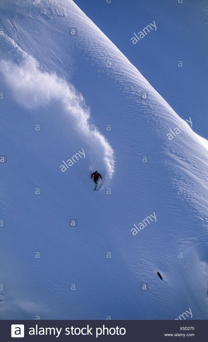 Man heli skiing in BC, Canada. - Stock Image