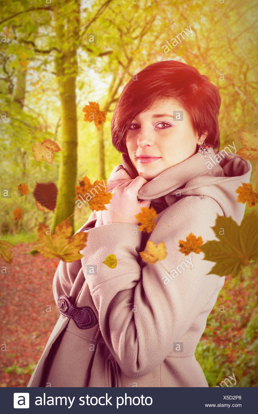 Composite image of portrait of beautiful woman wearing winter coat - Stock Image